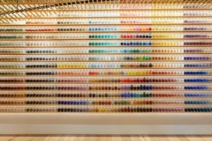 a wall of colorful pigments