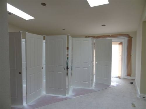 The beauty of this system is you can spray all sides of the doors at once and you get fit a lot of doors in a smaller area. & A Quick Way to Spray Doors | The Painting Company
