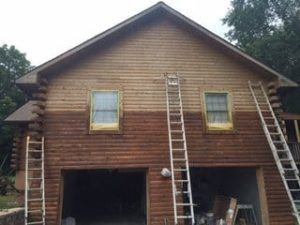 staining a log home